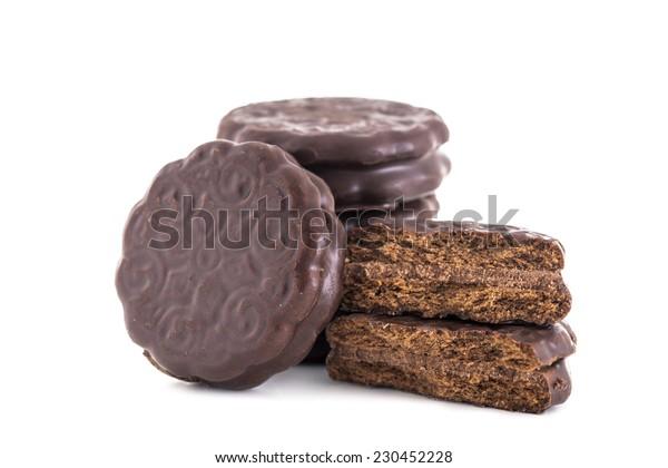 Bitten biscuit sandwich with chocolate. White background.