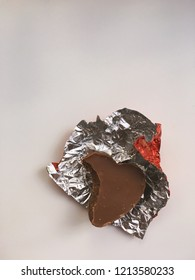 Bitten chocolate heart in the wrapped paper