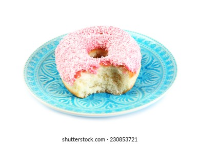 Bitten delicious donut on plate isolated on white