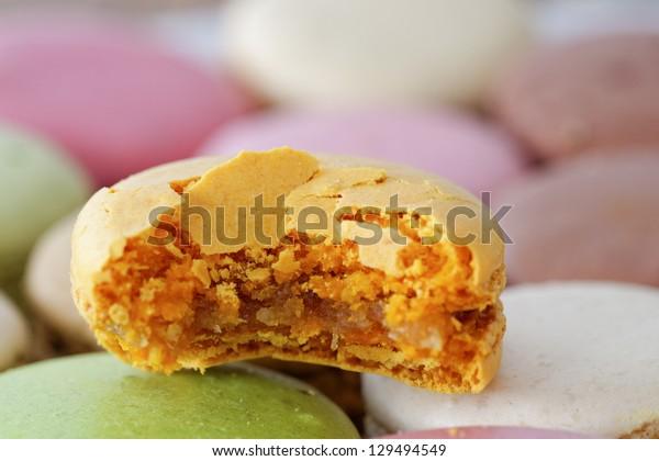 A bitten ginger bread macaron