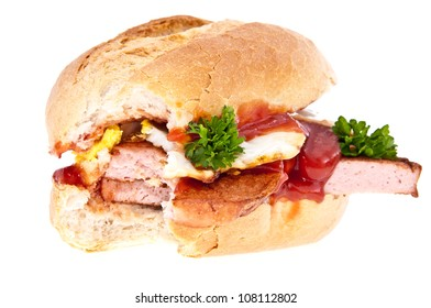 Bitten off meat loaf with fried egg on top isolated on white