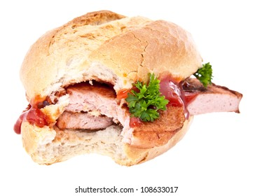 Bitten off meat loaf roll with parsley and ketchup isolated on white background