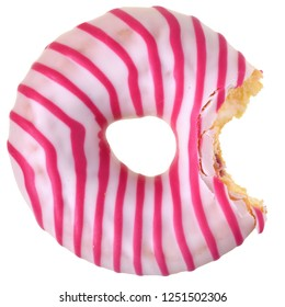 Bitten strawberry donut covered with pink icing top view Isolated on white background.