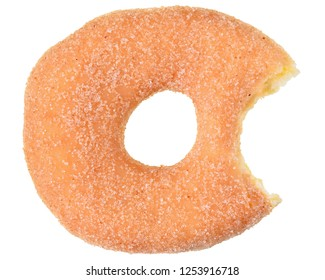 Bitten sugar donut top view isolated on white background.