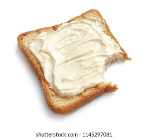 Bitten toast bread with cream cheese on white background
