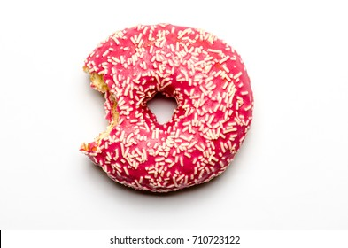 bitten-into donut doughnut with strawberry icing glaze