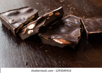 Bitter Almond Chocolate Pieces on Dark Wooden Surface. Organic Snacks.