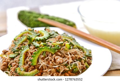 Bitter melon menu for healthy. Small green bitter melon or Bitter gourd Fried with shrimp paste, minced pork and vermicelli
