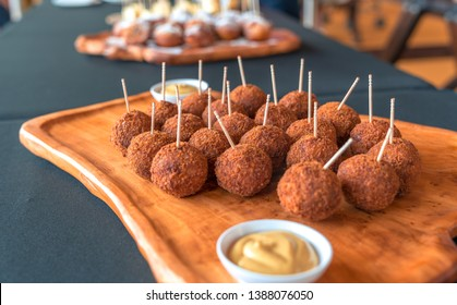Bitterballen - Dutch meat based snack , typically containing a mixture of beef . butter and flour for thickening Includes  parsley , salt and pepper.