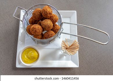 Bitterballen are a Dutch meat-based snack served with mustard, typically containing a mixture of beef or veal, Bitterballen are one of Holland's favorite snacks.