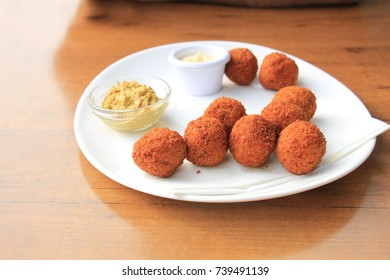 Bitterballen with mustard, warm fried snack, served in the Netherlands