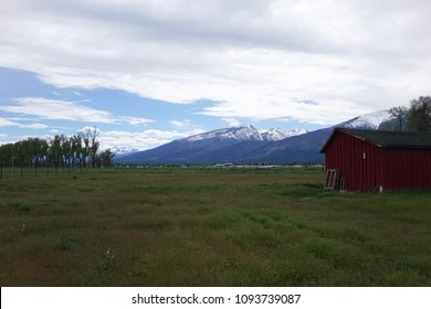 The Bitterroot Mountains provide a beautiful background for farms and ranches near Hamilton, Montana.