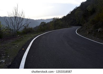 Bitumen concrete road along with edge line with road blinker