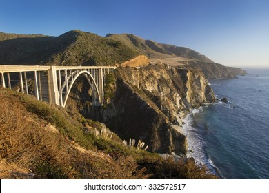 Bixby Bridge in Big Sur, California - part of the scenic Pacific Coast Highway (SR 1) - at sunset.