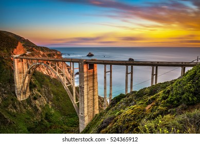 Bixby Bridge (Rocky Creek Bridge) and Pacific Coast Highway at sunset near Big Sur in California, USA. Long exposure.