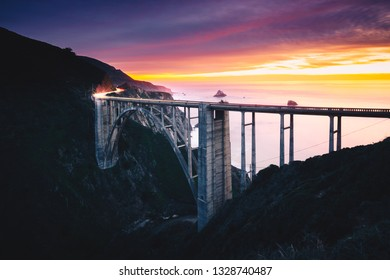 Bixby Creek Bridge with Colorful Sunset and Car Light Trails, Big Sur, CA