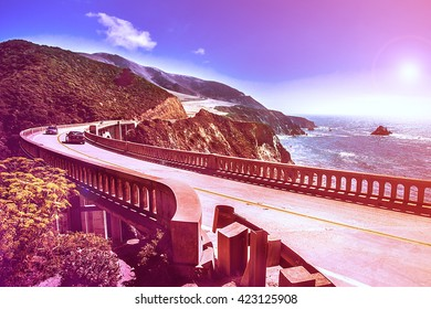 Bixby Creek Bridge on Highway #1 at the US West Coast traveling south to Los Angeles, Big Sur Area - Picture in a dreamy look with purple fall color look