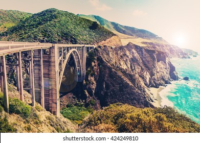Bixby Creek Bridge on Highway #1 at the US West Coast traveling south to Los Angeles, Big Sur Area, California - Picture in a dreamy look with cross processed color look
