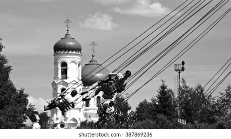 BIYSK, ALTAI KRAI-JUNE 14, 2012:The blue dome of the church Uspensky.Carousel in front of the church