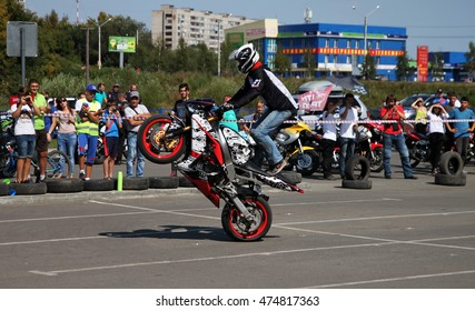 BIYSK, RUSSIA - AUGUST 28,2016:Open competitions Moto-Gymkhana in Biysk this sporting test of time, where the riders have to skillfully avoid all obstacles.