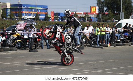 BIYSK, RUSSIA - AUGUST 28,2016:Open competitions Moto-Gymkhana in Biysk. This sporting test of time, where the riders have to skillfully avoid all obstacles.