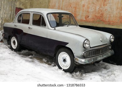 BIYSK, RUSSIA - CIRCA, FEBRUARY 2019: Retro car Moskvich 403, old soviet car on a snowy city street.
