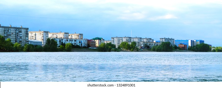BIYSK, RUSSIA-CIRCA, JUNE 2017: City river embankment panorama. Cityscape of Biysk, Biya river embankment.