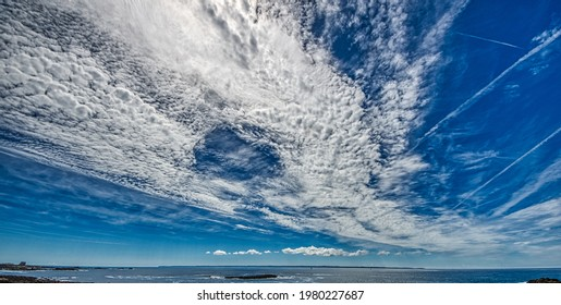 Bizarre clouds in the sky of the Cote Sauvage in the Quiberon peninsula, Morbihan region in Brittany, France. HDR image