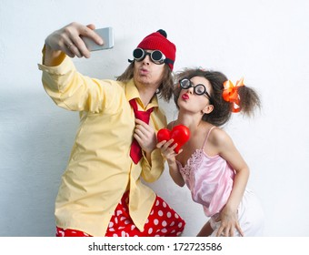 Bizarre couple in love is photographed on a mobile phone