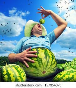 Bizarre farmer with watermelon instead of the abdomen on field in summer