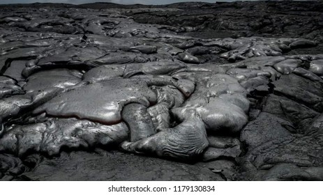 Bizarre formations on the lava fields. The shiny rock consists of very fresh lava.