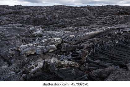 Bizarre formations on the lava fields of Puu Oo, Big Island Hawaii. The shiny rock consists of very fresh lava.
