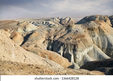 Bizarre layered mountains in the desert park Altyn Emel in Kazakhstan