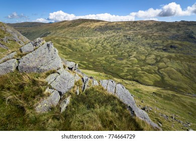 Bizarre moon like landscape at stake pass Cumbria Way England from high view