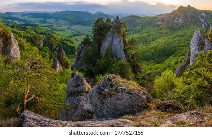 Bizarre rock towers with spring colors of leaves on the trees. Paradise for climbers and adventurers, Sulovske skaly, Sulov, Slovakia.  - Shutterstock ID 1977527156
