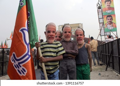 BJP supporters are seen wearing masks of Indian Prime Minister Narendra Modi during Rajnath Singh's election rally ahead of the Lok Sabha elections, at Shastri Park on May 1, 2019 in Delhi, India.