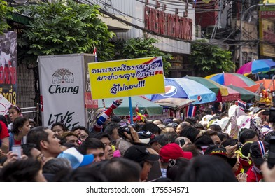 BKK - FEB 1, 2014: Anti-government protesters march through Bangkok's Chinatown.