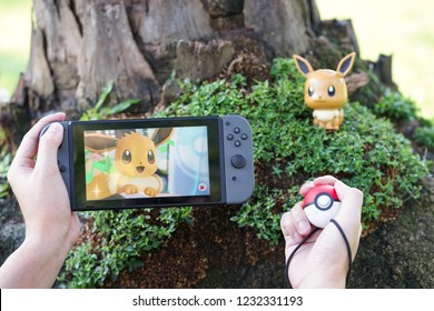 BKK - Nov 17, 2018 : A photo of Pokemon Let's go on Nintendo Switch. 2 special editions launched on Nov 16, 2018 : Pokemon Let's go Eevee & Pokemon Let's go Pikachu. Pokeball plus is additional option