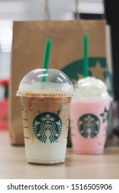 BKK - Sept 28, 2019 : Starbucks cold drinks with soft focus on caramel macchiato and raspberry frappucino on blurred background. Starbucks is a successful multinational coffee with branches worldwide.