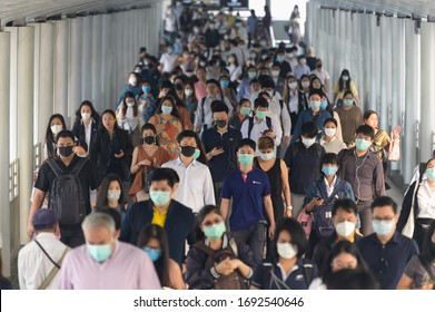 BKK THAILAND, 16 Mar 2020 :Group of many salary man wearing face mask for protect coronavirus in air while going to their workplace during coronavirus outbreak crisis in Bangkok at moring rush hour.