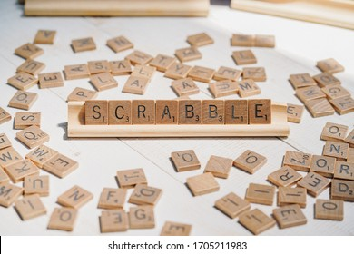 BKK, Thailand - Apr 11, 2020 : A scrabble crossword board game with genuine wood tiles and racks Scrabble is a classic word game this version is copyright by Selchow and Righter (1948).