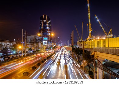 BKK, Thailand - Nov 16, 2018: Traffic jam and new Provincial Electricity Authority (PEA) building background. Annually an estimated 150,000 cars join the heavily congested streets of the Thai capital.