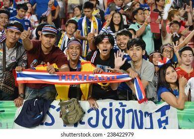 BKK,THA-DEC.16:Thai fans celebrates after won Philippine during the competition 2014 AFF Suzuki Cup between Thailand and Philippines at Rajamangala stadium on December 10, 2014 in Bangkok, Thailand.