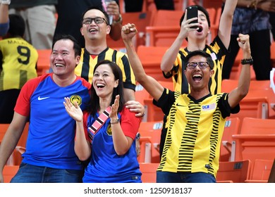 BKK,THA-DEC.5: Malaysia fans in cheer up during the AFF Suzuki Cup 2018 between Thailand and Malaysia at Rajamangala stadium on December 5, 2018 in Bankok, Thailand.