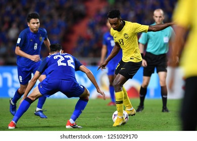 BKK,THA-DEC.5: Mohamadou Sumareh(13) of Malaysia in action during the AFF Suzuki Cup 2018 between Thailand and Malaysia at Rajamangala stadium on December 5, 2018 in Bankok, Thailand.