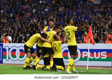 BKK,THA-DEC5: Norshahrul Idlan Talaha(9) of Malaysia and team-mate celebrate during the AFF Suzuki Cup 2018 between Thailand and Malaysia at Rajamangala stadium on December 5, 2018 in Bankok, Thailand