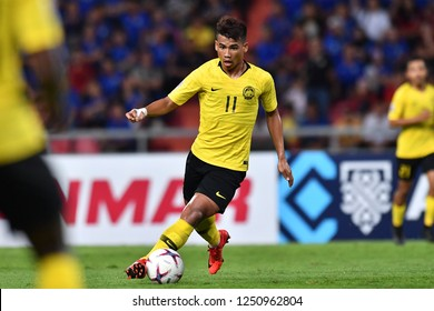 BKK,THA-DEC.5: Safawi Rasid(11) of Malaysia in action during the AFF Suzuki Cup 2018 between Thailand and Malaysia at Rajamangala stadium on December 5, 2018 in Bankok, Thailand.