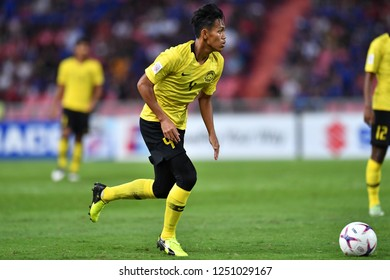 BKK,THA-DEC.5: Syahmi Safari(4) of Malaysia in action during the AFF Suzuki Cup 2018 between Thailand and Malaysia at Rajamangala stadium on December 5, 2018 in Bankok, Thailand.