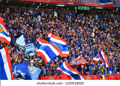 BKK,THA-DEC.5: Thailand fans with national flag in action during the AFF Suzuki Cup 2018 between Thailand and Malaysia at Rajamangala stadium on December 5, 2018 in Bankok, Thailand.