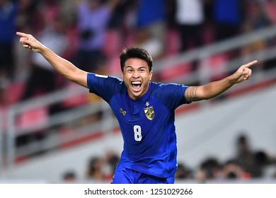 BKK,THA-DEC.5: Thitiphan Puangjan(8) of Thailand celebrate after scoring during the AFF Suzuki Cup 2018 between Thailand and Malaysia at Rajamangala stadium on December 5, 2018 in Bankok, Thailand.